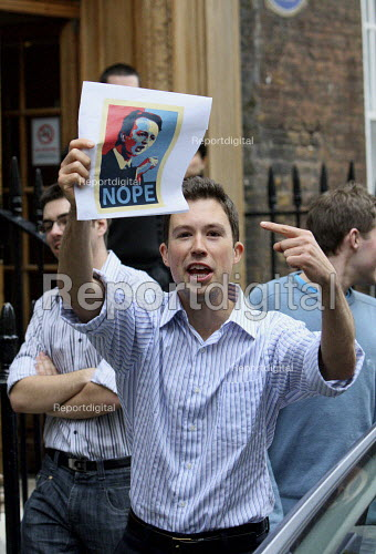 A man holding up a Nope to David Cameron poster outside St Stephen's Club London. - Justin Tallis - 2010-05-07