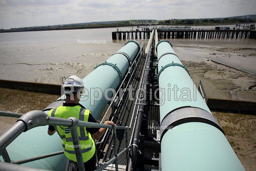 A worker walks between water transfer pipes at Thames Gateway Water Treatment Works. It is first plant of its kind to be built in the UK converting brackish water from the River Thames into clean drinking water as well as the only place in the world to use first four-stage reverse osmosis. Becton, Greater London. - Justin Tallis - 2010-06-17