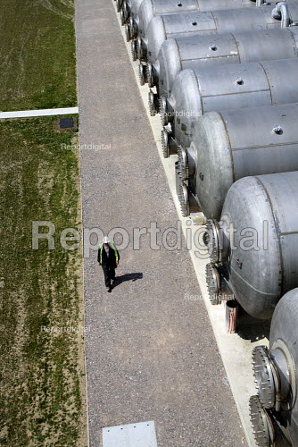 A worker walks past horizontal salinity buffer tanks at Thames Gateway Water Treatment Works. It is first plant of its kind to be built in the UK converting brackish water from the River Thames into clean drinking water as well as the only place in the world to use first four-stage reverse osmosis. Becton, Greater London. - Justin Tallis - 2010-06-17
