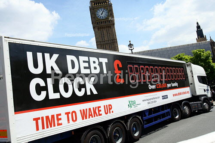 UK Debt Clock Tax Payers Alliance advert passing Parliament, tour to highlight UK National Debt and Government borrowing, London - Justin Tallis - 2010-06-22