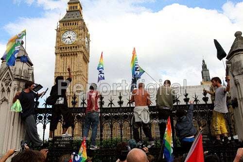 Parliament Square peace camp protesters climbing onto the gates in front of the Houses of Parliament. London. - Justin Tallis - 2010-07-02