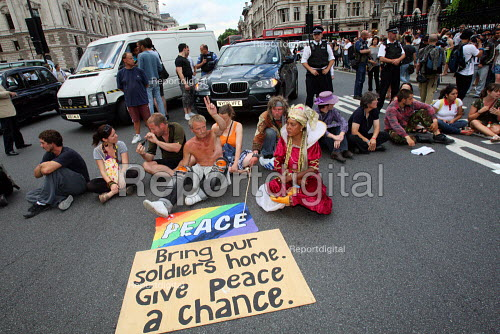 Parliament Square peace camp protesters block the road in front of the Houses of Parliament. London. - Justin Tallis - 2010-07-02
