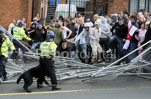 English Defence League protestors clash with police. Breaking down metal fences. Dudley. - Justin Tallis - 2010-07-17