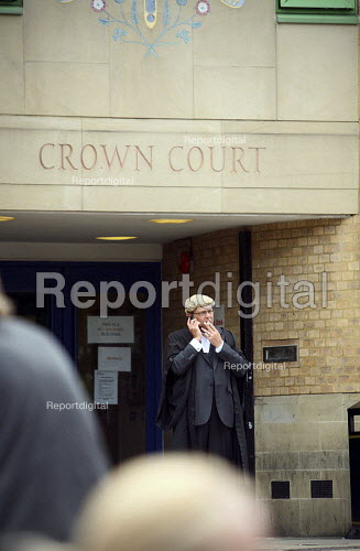 Barrister outside Luton Crown Court on his phone having a cigarette break. - Justin Tallis - 2010-07-22