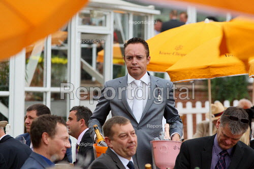 Racegoer with a couple of bottles at Venue Cliquot champagne bar. Goodwood racecourse. - Justin Tallis - 2010-07-29