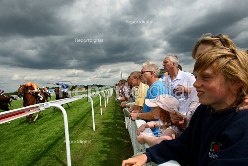 Racegoers watching at race at Goodwood racecourse. - Justin Tallis - 2010-07-29