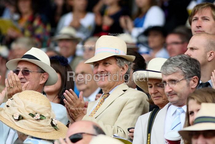 Wealthy racegoers watching the race. Goodwood racecourse. - Justin Tallis - 2010-07-29
