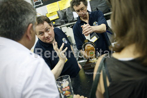 Having a chat with the bar man about the beer at The Great British Beer Festival, Earls Court, London. - Justin Tallis - 2010-08-05