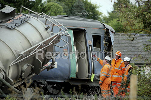 Rail crash investigators checking the wreckage of the train and a waste disposal tanker which collided at an unmanned level crossing. Little Cornard. Suffolk. - Justin Tallis - 2010-08-18