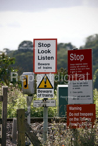Unmanned level crossing telephone and stop look listen, stop and do not trespass signs. Little Cornard. Suffolk. - Justin Tallis - 2010-08-18