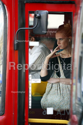 A woman at the front of a packed rush hour bus during a strike by RMT and TSSA tube workers against job losses, London. - Justin Tallis - 2010-09-07