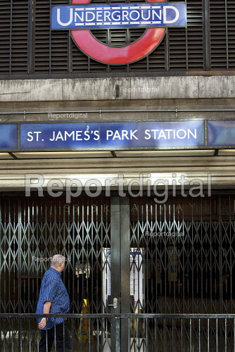 A man walks past St James Park underground station during a strike by RMT and TSSA tube workers against job losses, London. - Justin Tallis - 2010-09-07