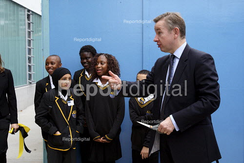 Michael Gove MP shaking hands with school children on a visit to the Globe Academy in Southwark, South London. - Justin Tallis - 2010-09-13