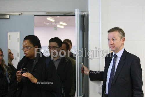 Michael Gove visiting the Globe Academy in Southwark, South London. Holding the door open. - Justin Tallis - 2010-09-13