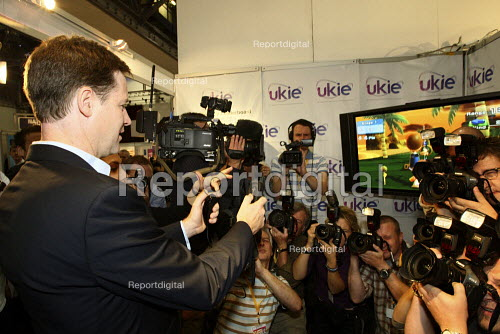 Deputy Prime Minister Nick Clegg playing Nintendo Wii during a tour of the conference exhibition hall. 2010 Liberal Democrat conference. Liverpool. - Justin Tallis - 2010-09-20