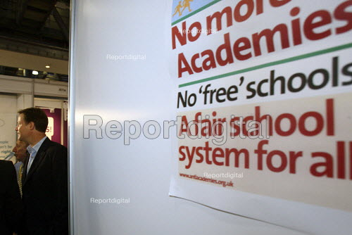 Deputy Prime Minister Nick Clegg walking past Anti Academies stall without stopping during a tour of the conference exhibition hall. 2010 Liberal Democrat conference. Liverpool. - Justin Tallis - 2010-09-20