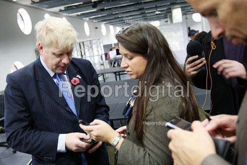 Boris Johnson with his assistants, getting information and news about the FBU firefighters strike the morning after it was called off, visiting Ravensbourne College, North Greenwich, London - Justin Tallis - 2010-11-05