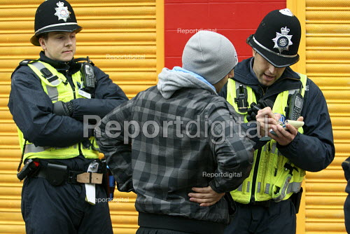 Police stop and search a young man ahead of an English Defence League demonstration in Leicester. - Justin Tallis - 2010-10-09