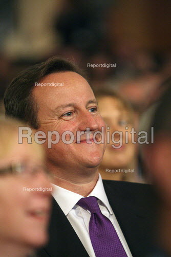 Prime Minister David Cameron sitting in the audience listening to the 2010 Conservative Party Conference, Birmingham. - Justin Tallis - 2010-10-03
