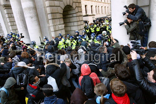 Riot police clash with students trying to get out of the kettle. Protest against education cuts and increased tuition fees, Whitehall, London. - Justin Tallis - 2010-11-24
