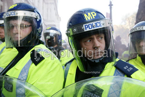 Riot police holding the line. Protest against education cuts and increased tuition fees, Whitehall, London. - Justin Tallis - 2010-11-24