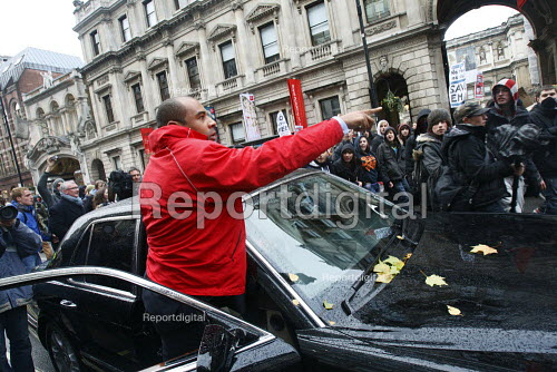 Bentley Arnage car driver gets out and shouts at students. The driver tried to barge through an impromptu march by students who walked out in protest against plans to raise tuition fees and cuts in university funding. London. - Justin Tallis - 2010-11-30