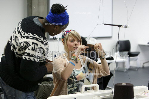 Students studying for a BA Hons in Fashion Textiles in a knitting workshop held in an open plan teaching area. Ravensbourne specialist higher education college, Greenwich, London. - Justin Tallis - 2010-12-06