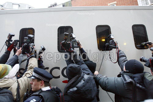 Press photographers frantically scramble to get a picture of Julian Assange through the blacked out windows of a prisoner transport vehicle. The Wikileaks website founder appeared in court after being accused by Swedish authorities of rape. City of Westminster Magistrates Court London. - Justin Tallis - 2010-12-07
