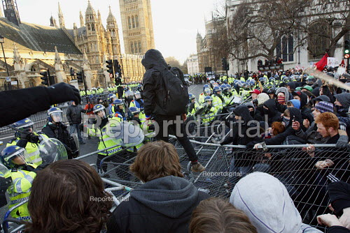 Students clash with riot police whilst they are contained in Parliament Square. Demonstration against plans to raise tuition fees and cuts in university funding. Parliament Square. London. - Justin Tallis - 2010-12-09