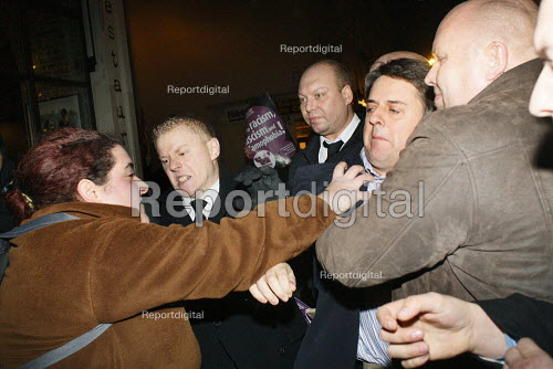 The security team of Nick Griffin BNP react as anti fascist protesters prevent him from speaking on a Q and A panel at The Front Line Club. London. - Justin Tallis - 2011-01-13
