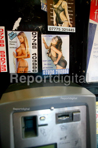 Prostitute calling cards in a London phone box on Soho. - Justin Tallis - 2009-06-11