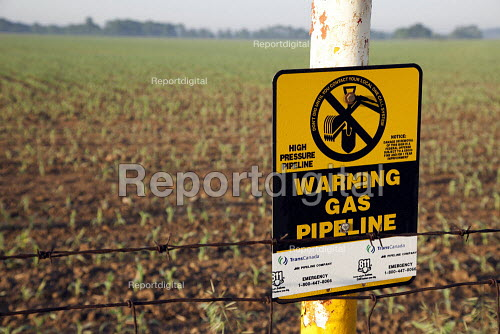 A marker at the edge of a farm field warns of a buried TransCanada natural gas pipeline. - Jim West - 2010-05-23