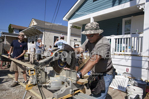 New Orleans, Louisiana - Volunteers help build a house for a low-income family through Habitat for Humanity. Many homes in the city are still in need of repair or rebuilding seven years after Hurricane Katrina. - Jim West - 2012-11-03