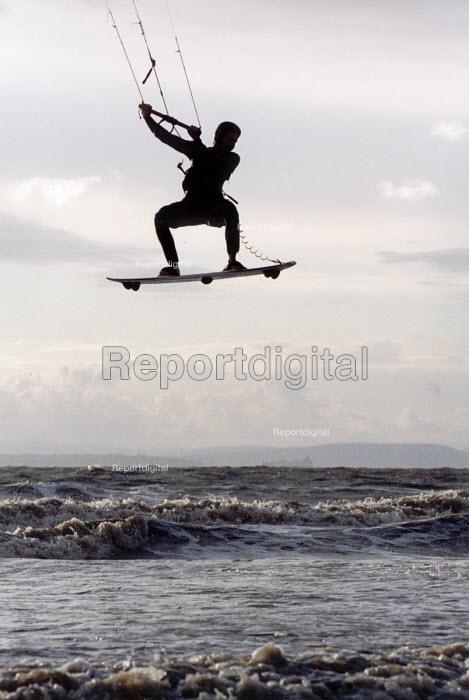 kite surfer jumps high in the air at Weston Super Mare beach - Paul Box - 2001-09-10