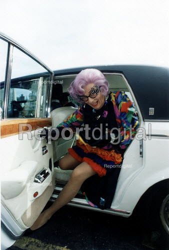 Dame Edna Everage arriving by Roll Royce car. Bristol. - Paul Box - 1984-07-14