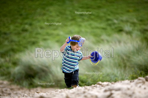 A young boy at Freshwater West beach in Pembrokeshire. - Paul Box - 2009-08-20