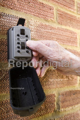 A Selwood Housing resident using a combination pad to gain entry to his home. Selwood manage quality affordable housing and provide support services for people in housing need. - Paul Box - 2009-08-03