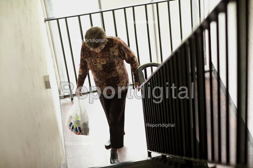 Selwood Housing residents returning with her shopping bag climbing the stairs. Selwood manage and maintain quality affordable housing and provide support services for people in housing need - Paul Box - 2009-08-03