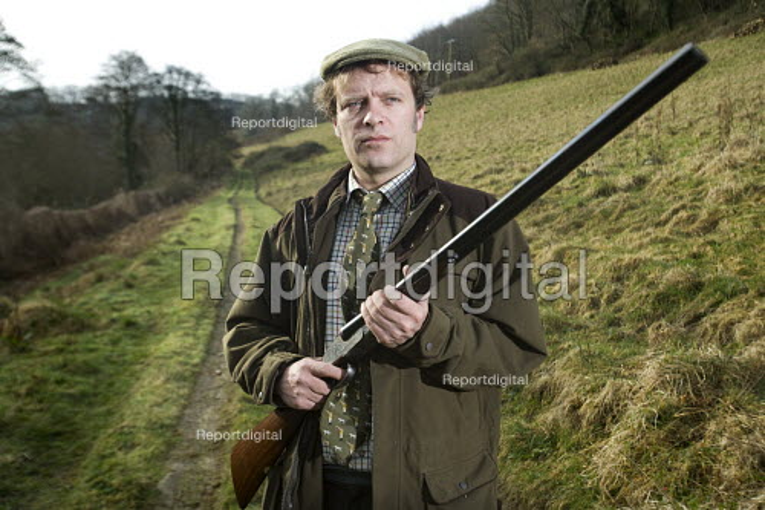 A shooting enthusiast with his double barreled shotgun, Exmoor. - Paul Box - 2009-03-16