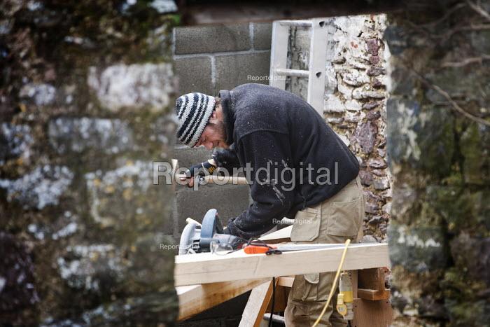 A carpenter cuts the oak A-frames for a barn conversion. - Paul Box - 2010-02-08