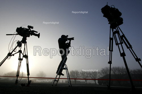 Tv crews and a photographer await the arrival of the 1st Battalion The Black Watch (Royal Highland Regiment) (1 BW) at base on December 11, 2004 at the Battlesbury Barracks, Warminster, England. The troops had served in the Iraq war and had suffered casualties. The Battalion may be closed due to cuts. - Paul Box - 2004-12-11