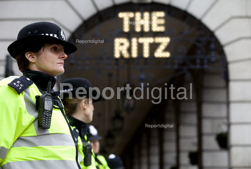 Police officers guarding The Ritz Hotel, a symbol of inequality. A Future That Works. March and rally organised by the TUC to protest against the government austerity policies and to call for an alternative economic strategy that puts jobs, growth and people first. London. - Paul Box - 2012-10-20