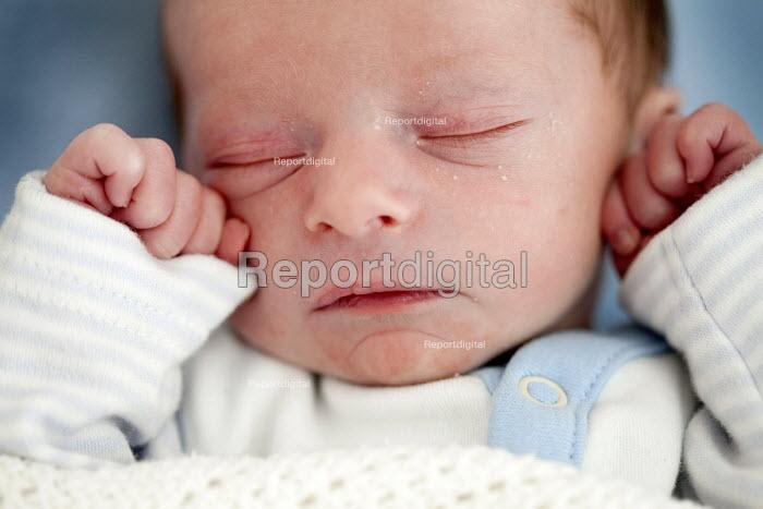 A newborn baby boy fast asleep - Paul Box - 2012-09-28