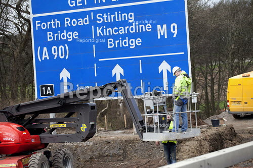 Worker with a cherry picker. Roadworks and road widening near on the M9 Junction 1A Edinburgh and the Forth road bridge. Scotland - Paul Box - 2012-03-14
