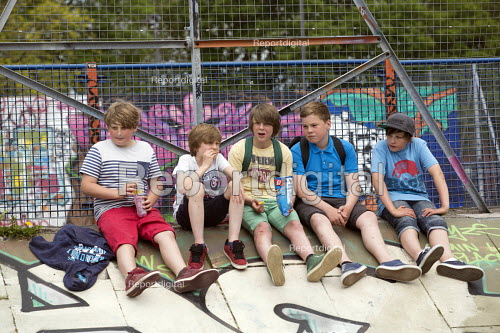 Group of boys in Dame Emily skate park. UpFest 2013 Europe's largest live urban arts festival with over 250 of the most groundbreaking graffiti artists from all around the world. Bedminster, Bristol. - Paul Box - 2013-05-31