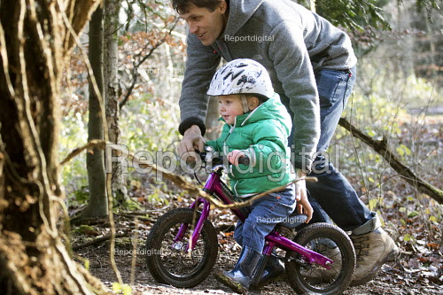 A father with his 2 year old boys on their balance bikes, Leigh Woods, Bristol - Paul Box - 2015-01-24