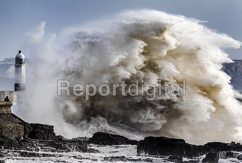 Storm waves smash into the seafront, lighthouse and seawall, Porthcawl - Paul Box - 2015-01-15