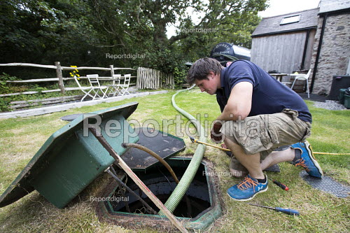 A tanker emptying a residential sewage treatment plant of human waste, Pembrokeshire. Wales - Paul Box - 2014-07-26