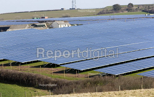 Solar farm being installed in Pembrokeshire in front of the Valero oil refinery, Rhoscrowther, Pembrokeshire. - Paul Box - 2015-03-26