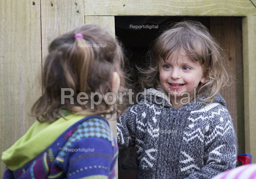 Children playing in the garden at home. A boy with some of his older friends, Bristol. - Paul Box - 2015-04-18